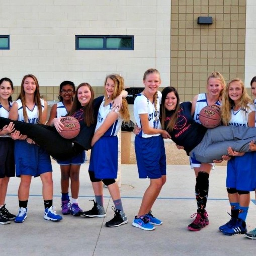 girls' basketball team holding coaches 2