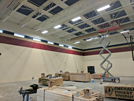 gymnasium under construction with freshly painted walls