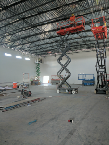 scissor lifts inside new construction of gym