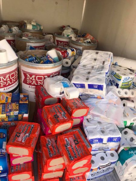pile of donated food and hygiene items inside truck