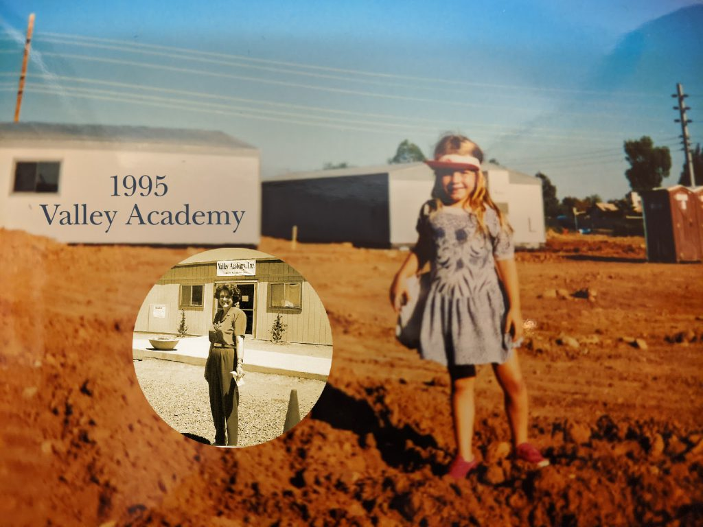 Young girl stands in dirt by portable school buildings labeled 1995 Valley Academy. Circle insert of her mother in front of School Office building.